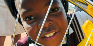 close-up, happy child, bicycle wheel, helmet
