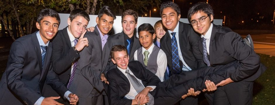 In this photo, a group of Jacob's best friends hold him up on the evening of his Bar Mitzvah.