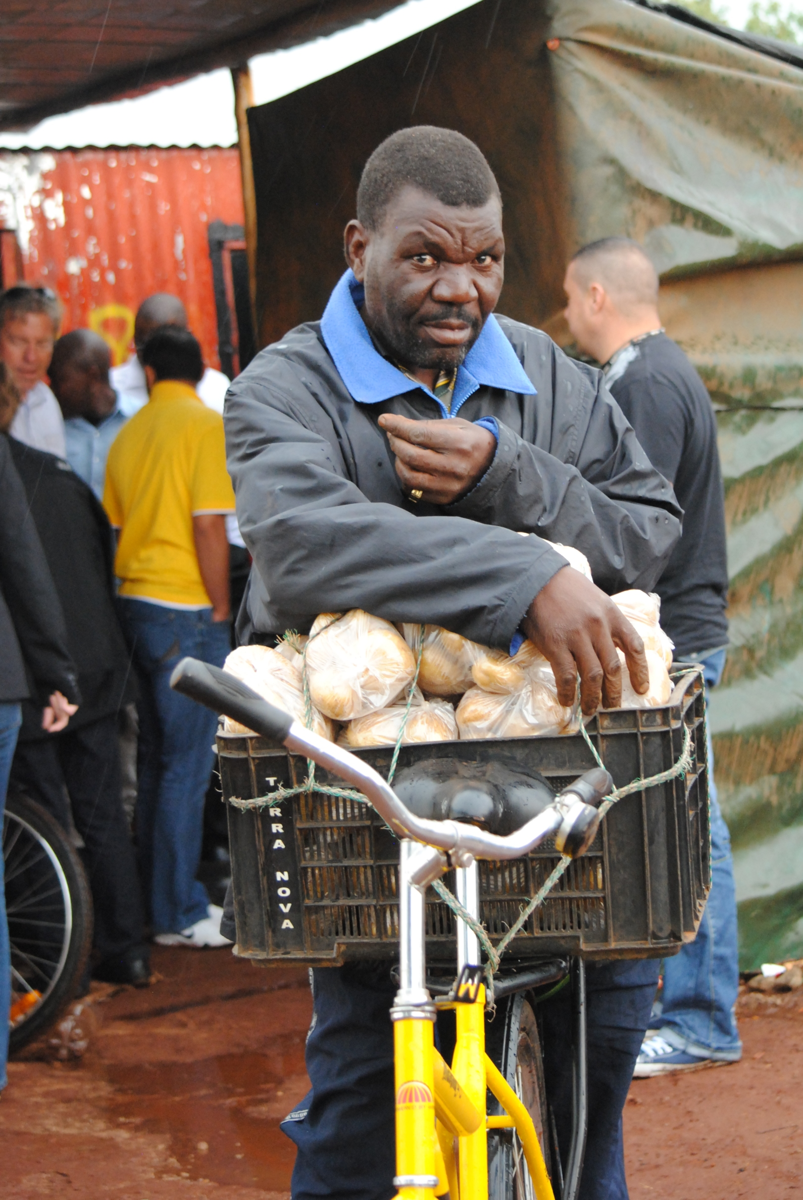 This man and his son grow potatoes, which they then load on their bicycles and sell at the local market