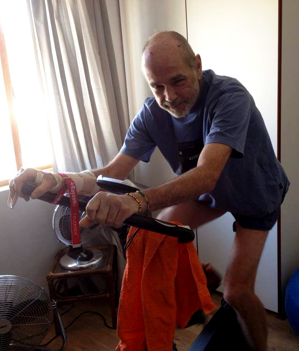 Colin on his first day on the stationary bike after discharge from hospital, Nine Peaks Tour