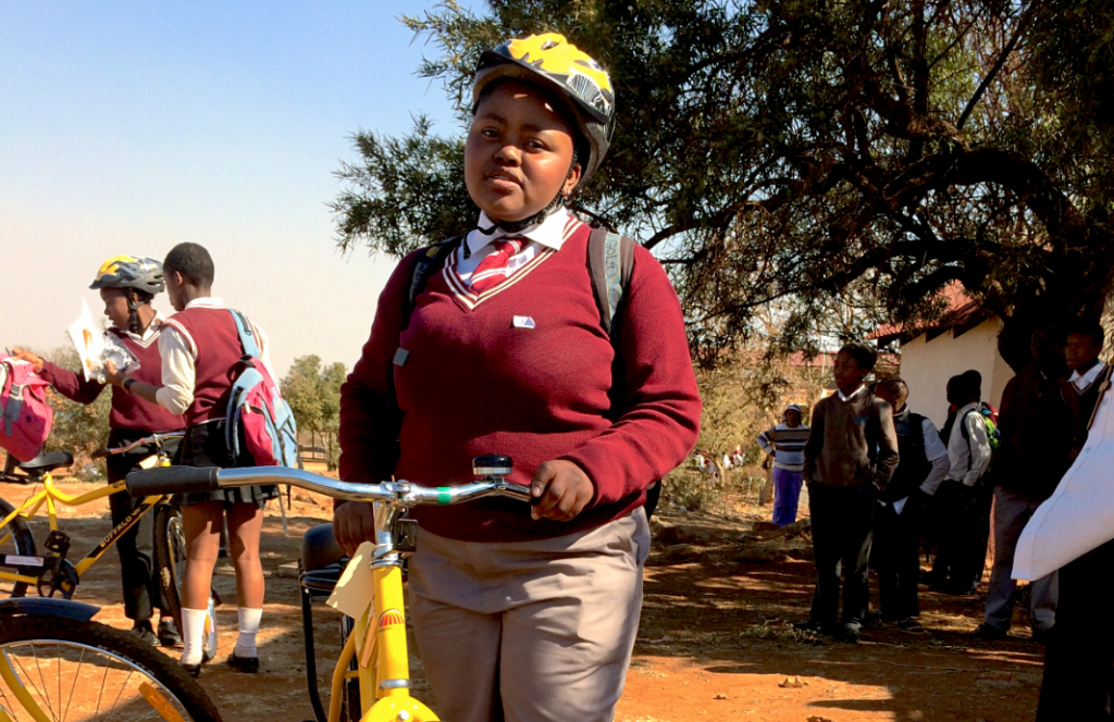 Thando (16) was the first child to receive the bicycle she earned today. She wants to be a dentist.