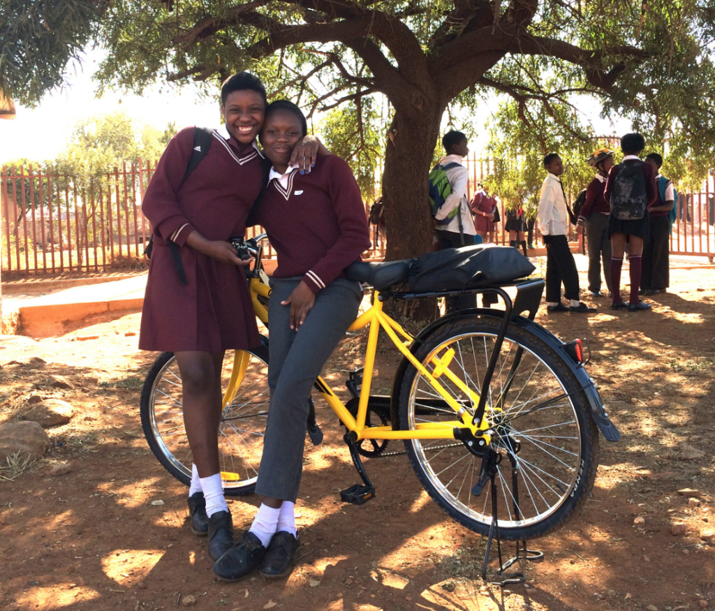Lokhuthule poses with her friend and her brand new bicycle. Her friend is hoping that Lokhuthule will give her lifts to school. If you want to help put more girls on bicycles you can make a difference by donating here.