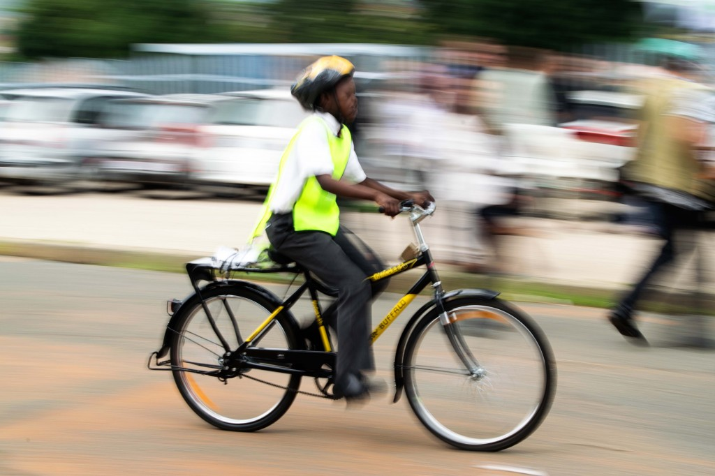 It's not long before the bicycle recipients have the hang of riding.