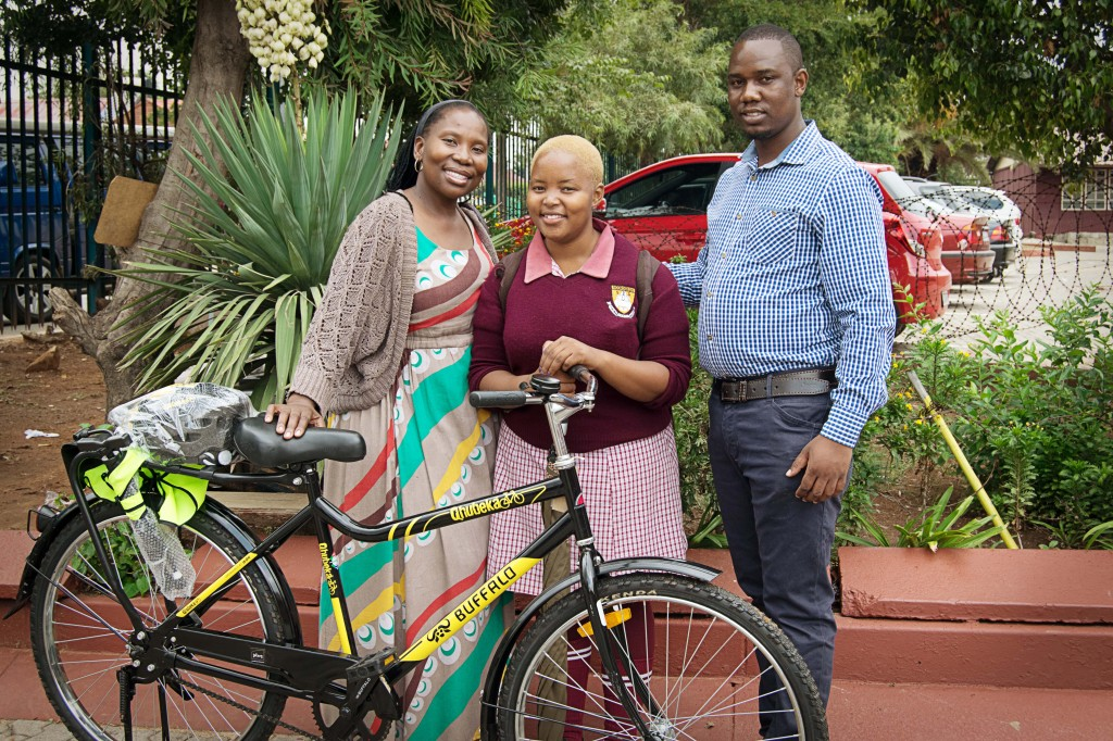 2015 bicycle recipient, Nompumelelo, with two school staff members.