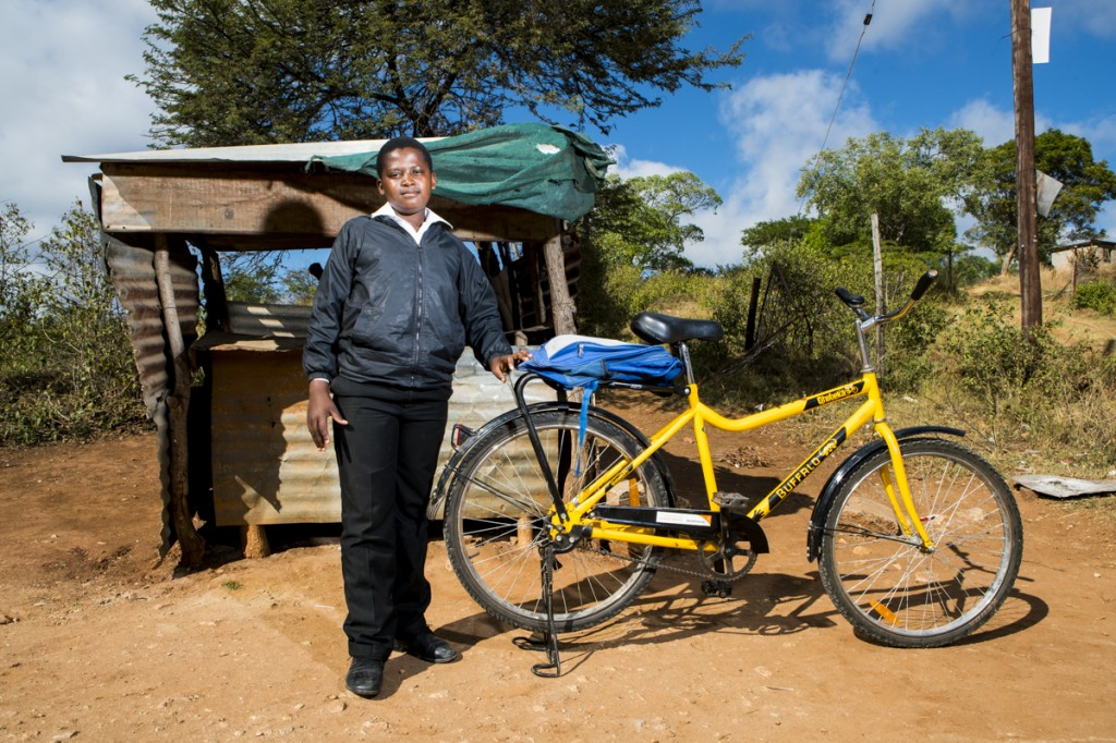 Mutemi with his new bicycle